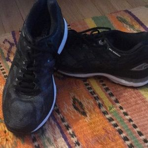 Black ASICS running shoes